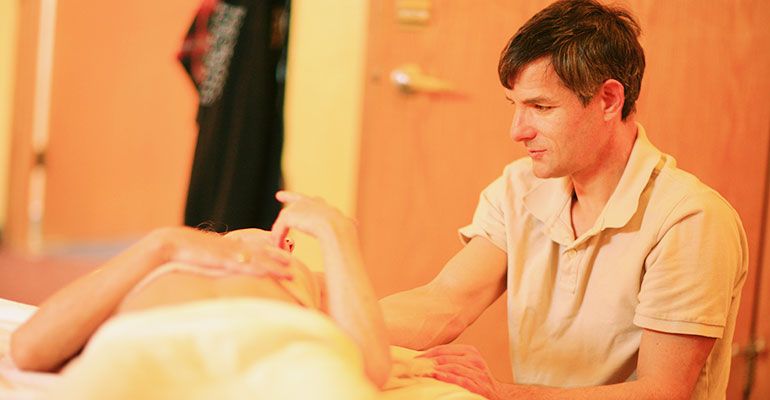 Masseuse and Client Interacting at Ashland Institute of Massage (AIM)